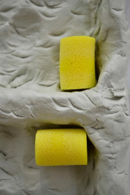 44 - Agnes Calf, Double Rotation (Earplugs), 2013, Clay, Acrylic Paint, Varnish, Foam Earplugs, 15 x 27 x 2.5cm (detail) copy